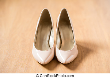 Clasic nude bride shoes on the floor