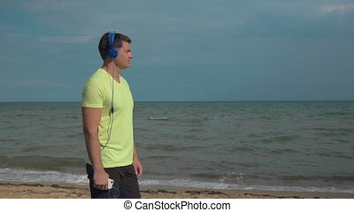 Listening to music and enjoying seascape - Slow motion of a...