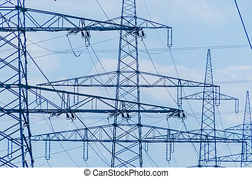 current asten a high voltage line - poles of a power line...