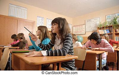 Diligent pupils - Diligent schoolchildren during lesson....