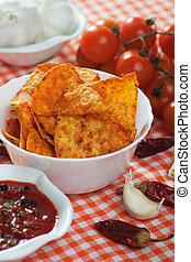 Tortilla chips slices - Tortilla chips with hot salsa dip,...