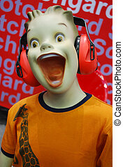 Enjoy Music - Teenager doll with open mouth in headphones...