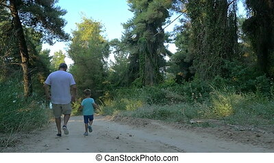 Grandson and grandfather running in the woods - Slow motion...