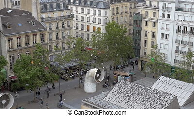Flock of pigeons flying on the city square in Paris