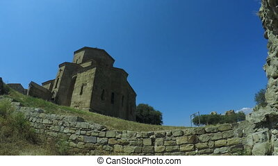 Antique stone church - Jvari monastery church at edge of...