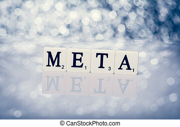 Written word of tiles with letters - meta - Created word of...