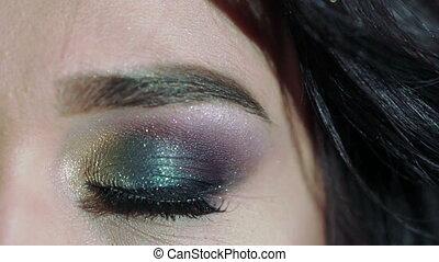 Close up of girl's big eye. Slowly