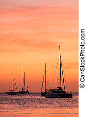 Boat sunset - silhouette of sail boat on sea at sunset...
