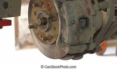 Dismantling Of Brake Disk At Auto Repair - CLOSE UP shot of...