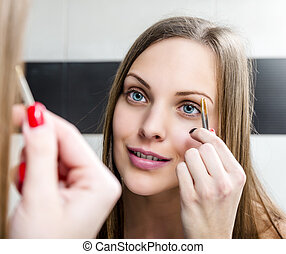 Shaping eyebrows with tweezer - Beauty fresh model girl...