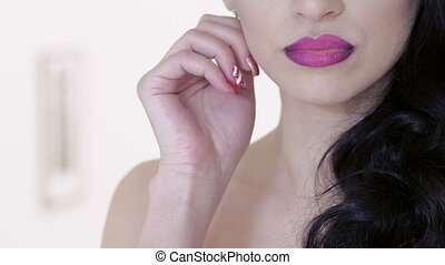 Portrait of womans friable lips, neck and hands Slowly
