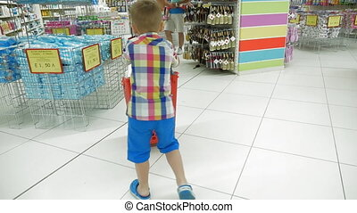 Child with shopping cart in the store - Slow motion...