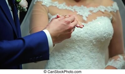 Groom and Bride Exchange Wedding Rings