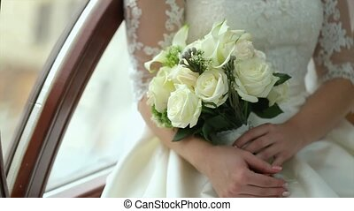 Bride Holding Her Wedding Bouquet in Slow Motion