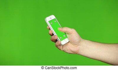 Closeup of Male Hands Holding Smartphone - Holding...