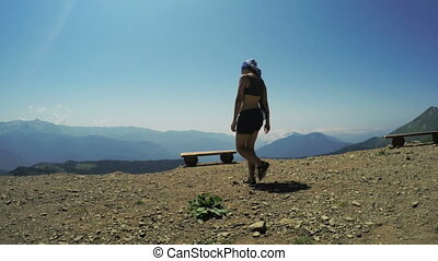 Girl on bench in mountains - Observation Deck Rosa Khutor to...
