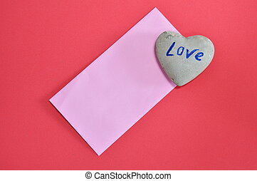 pink envelope and heart stone on red color foam board