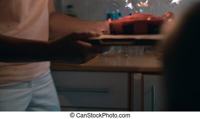 Mother and son carrying cake with sparklers - Slow motion...