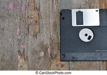 diskette on wooden board