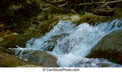 Cascading Water Of Mountain Stream Flowing Down