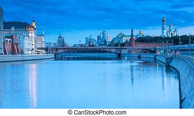 The view on the Kremlin, Moskva River Embankment and Zamoskvoretskiy Bridge in Moscow in the summer early morning before the sunrise, 4k, Time Lapse.
