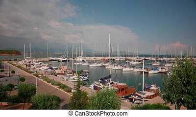 Sailing boats and yachts in a marina in a windy summer day. Time lapse, 4k