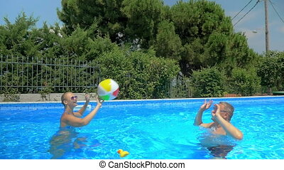 Enjoyable and active summer day in the pool - Slow motion of...