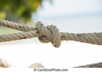 tied knot netting close up Texture background - Tied knot on...