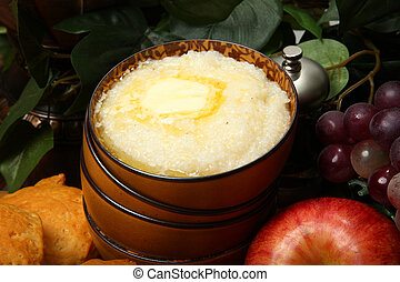 Bowl of Hot Grits in Kitchen - Bowl of hot grits and butter...