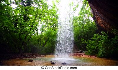 Small Waterfall Falling Down In Wild Forest