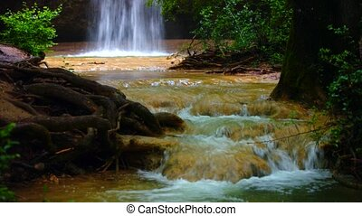 Small Waterfall Flowing In National Park - View of water of...