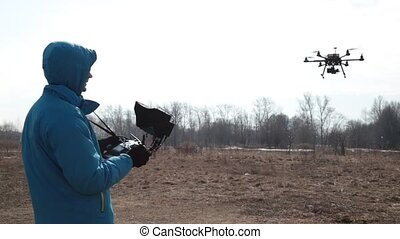 Quadcopter. Radio controlled hexacopter flying machine. Man...