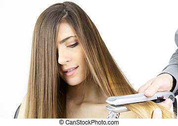 Gorgeous girl having long hair straightened isolated closeup