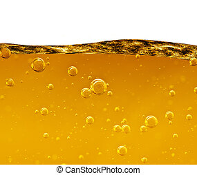 Wave from a yellow liquid with air bubbles on white...