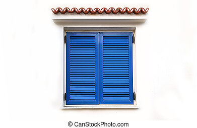 Window with closed blue shutters on white wall