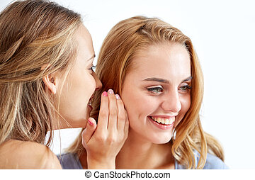 happy young women whispering gossip at home - friendship,...