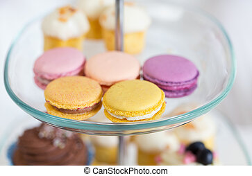 close up of cake stand with macaroon cookies - unhealthy...