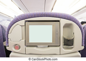 LCD screen in airplane seat - White LCD screen in an...