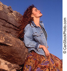 red head in jean jacket in desert