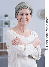 Happiness even in cancer - Portrait of senior woman in scarf...