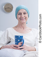 Positive sick woman after chemotherapy - Older smiling...
