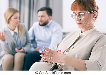 Worried psychologist and fighting couple - Older worried...