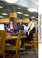 College students hanging out by library computers