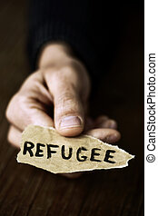 piece of paper with the word refugee
