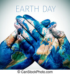 text earth day and man hands patterned with a world map...