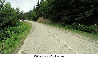 Mountain road turn - Camera moves to steadicam mountain road...