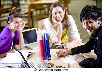 Three university students studying together - Male college...