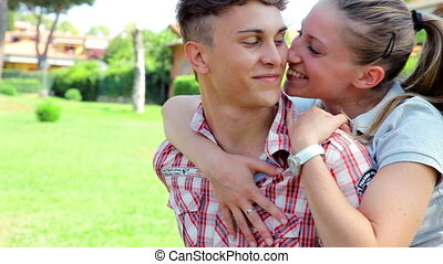 Couple in love kissing horseriding - woman happy sitting on...