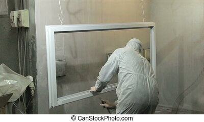 Worker in protect suit painting window with powder - Worker...