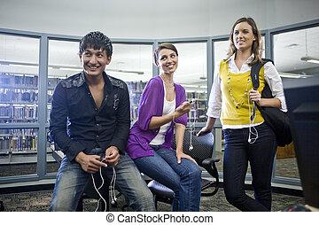 College students with music players in library